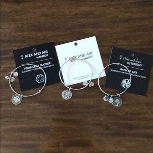Three Alex and Ani bracelets